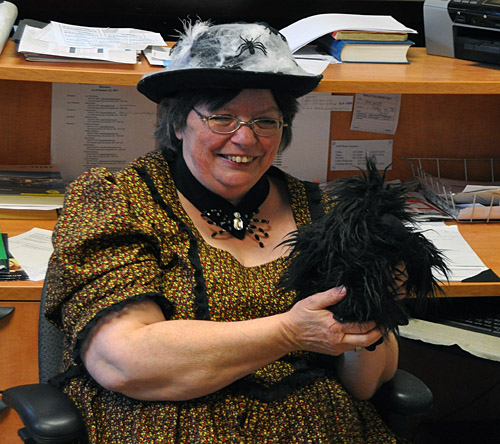 Cathy English poses with her Halloween pet — a rather scruffy-looking crow! David F. Rooney photo