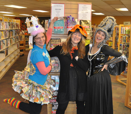 Over at the pubic library Zoe Knuff was the perfect Book Fairy, while Lucie Bergeron was a pumpkin witch and Kendra Runnalls had a Marie Antoinette thing going on... right down to the guillotine's bite.  David F. Rooney photo