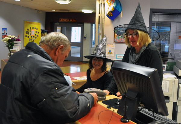 Checking in at the Aquatic Centre? First you had to get by these two witches — Megan MacIsaac and her sister in the dark arts Suzanne Grieve.  David F. Rooney photo