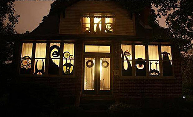 If you'd like to really decorate your house for Halloween but don't want to splurge on plastic decorations here's an effective alternative: create Halloween cutouts and tape them to you windows.