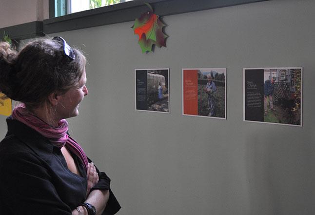 Jennifer Greenwood enjoys the small display on Revelstoke's master gardeners. David F. Rooney photo