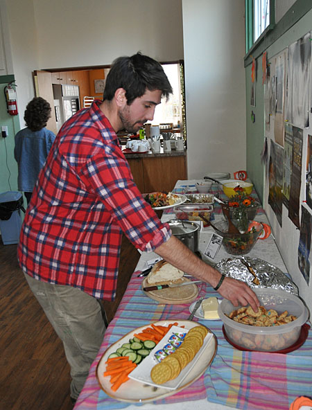 Matt Keeler snags a tasty looking cookie for dessert. The potluck supper was pretty good. David F. Rooney photo