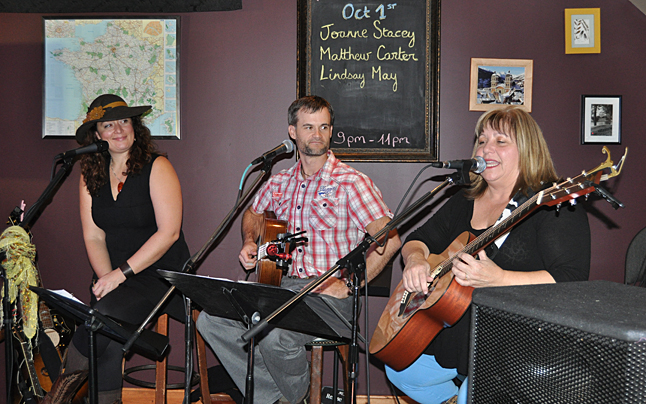Revelstoke's Joanne Stacey (right) sang with Matthew Carter and Lindsay May (left) at Benoit's Wine Bar during the opening night of Revelstoke's first Cornucopia Festival. David F. Rooney photo