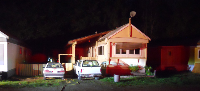 A Friday evening kitchen fire devastated a mobile home on Catherwood Road. Fire Chief Rob Girard said the fire began at 9:02 pm and a 911 call yielded a swift response from the Fire Recue Service., which sent 25 firefighters to the scene. N o one was injured during this incident. Photo courtesy of the Revelstoke Fire Rescue Service