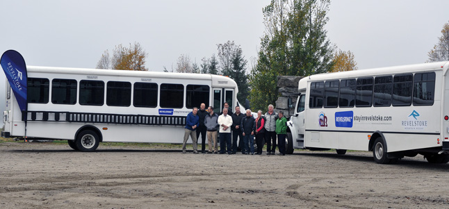 Revelstoke has a brand-new shuttle bus to deliver skiers to and from RMR. The 45-seat bus, shown on the right in this photo taken last Tuesday, October 15, brings the number of ski shuttles to three and they'll be well used. Two will be in operation at any one time. Posing this photo are (from left to right): RMR General Manager Rob Elliott, Community Economic Development Director Alan Mason, Engineering Director Mike Thomas, RMR's Steve Bailey, Mayor Dave Raven, Councillors Gary Starling, Tony Scarcella, Linda Nixon and Phil Welock, and driver Lisa Longinotto. David F. Rooney photo