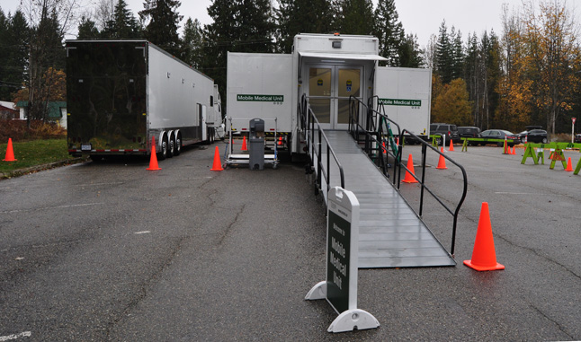 The Mobile Medical Unit is comprised of two tractor trailers. The one on the left is the support vehicle, which contains an office, staff lounge, two beds, tools, medical supplies and generators. The unit on the right contains a surgical suite, diagnostic imaging equipment and other devices. David F. Rooney photo