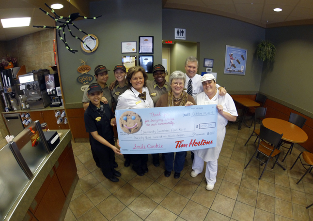 The annual Smile Cookie campaign at Tim Hortons was a huge success. Franchise owners Brian and Donna Lecompte and their staff raised $2,390 to help support the Community Connections Food Bank. Food Bank Coordinator Patti Larson was all smiles as she accepted their donation. Now that's something to smile about. Photo courtesy of Brian and Donna Lecompte