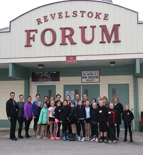 Ben and Jadene Ferreira (left) pose with the coaches and young women of the Revelstoke Figure Skating Club. Photo courtesy of Jennifer Walker-Larsen