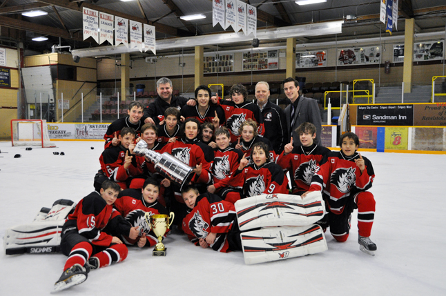 The White Horse Mustangs bantam team were the big winners at the bantam tournament held two weeks ago at the Forum. The kids were pleased to be the victors and even happier when they got their photo taken with the Revelstoke Minor Hockey Association's new Cooper's Challenge Cup. That's the one that looks just like another famous trophy — the Stanley Cup. That rophy will stay in Revelstoke and the winner from this tournament, and future ones, get to take home another cup. Photo courtesy of the Whitehorse Mustangs