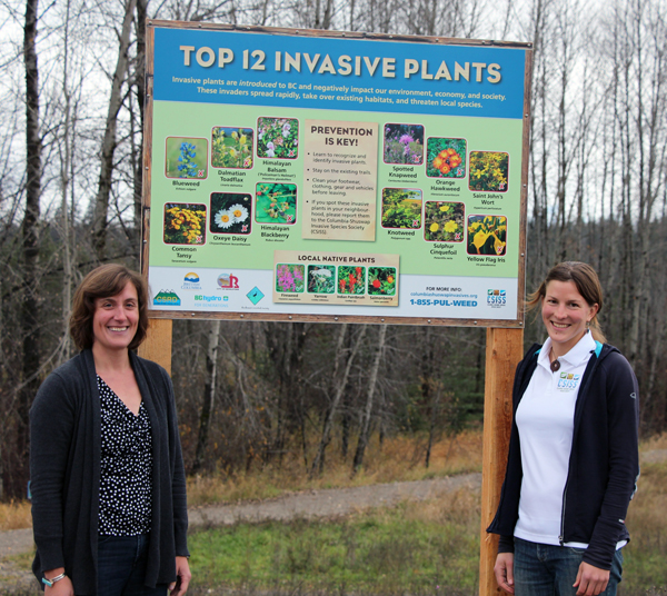 BC Hydro's Jennifer Walker-Larsen poses with CSISS Coordinator Natalie Stafl next to the new interpretive sign meant to educate the public about local invasive plants. BC Hydro is a major supporter of the new society. Photo courtesy of the Columbia Shuswap Invasive Species Society