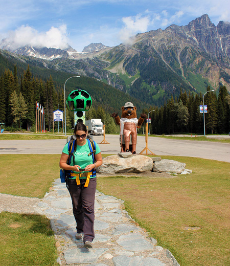 """Parks Canada mascot """"Parka"""" poses in the """"Breeches of MissConduct"""", a mountaineering photo opportunity in Glacier National Park as the Google Trekker goes by.  Photo courtesy of Parks Canada"""