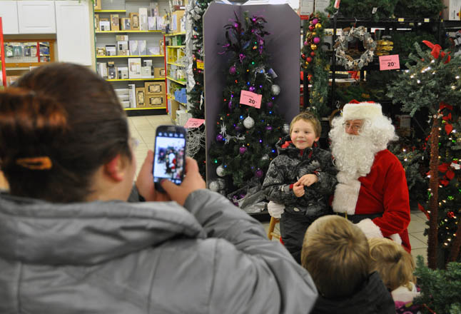 Santa always brings smiles to children's faces, just as he did here at Home Hardware's Grand Reopening on Saturday, November 23. The store is under new ownership and has added new lines of merchandise and a flooring section. David F. Rooney photo