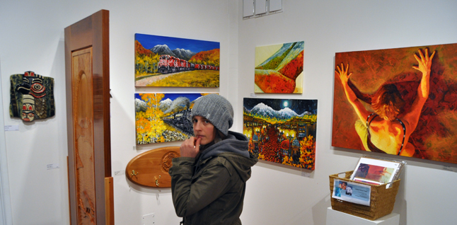 Megan Tabor considers her options while browsing through ArtFirst!. David F. Rooney photo