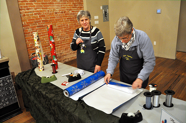 Donna Clapton and Sharon McCrae were two of the Beta Sigma Phi ladies who offered to gift wrap any of the goodies shoppers picked up on Friday evening. They did a lovely job on the steel oak leaf I picked up at ArtFirst! Thanks, again. ladies. David F. Rooney photo