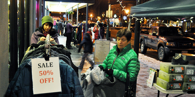 Across the street shoppers including Maria Stagliano pondered a purchase at Wearabouts. David F. Rooney photo