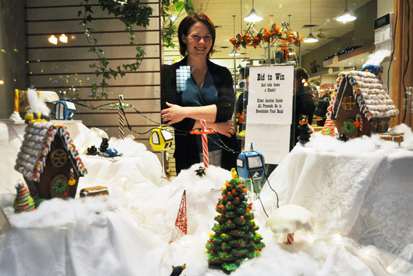 Nicole Cherlet poses with the gingerbread houses she created as a silent auction item to raise money for the Food Bank. If you'd like it drop on by Chantilly Kotchen, Ned 'n' Bath to submit your bid. David F. Rooney photo