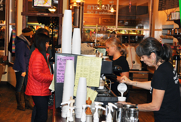 Kevan McCroy whips up a perfect hot drink for a customer at The Modern on Friday night. David F. Rooney photo
