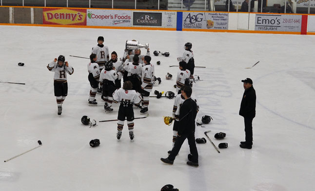 The home town Pee Wee Grizzlies celebrate their victory by hoisting the Cooper's Challenge Cup that is awarded to every team winning a Revelstoke Minor Hockey tournament. David F. Rooney photo