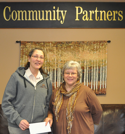 Lise Tataryn (left) presented Community Connections Food Bank Coordinator Patti Larson with a cheque for $1,000 from the Public Service Alliance of Canada's Branch 20105 which represents federal employees in Revelstoke. It was a timely donation and will help the Food Bank meet public demand in the run up to Christmas. Lise said her union also $1,000 to the Golden Food Bank. David  F. Rooney photo