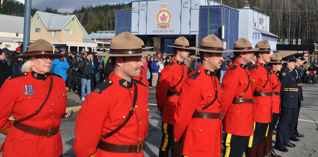 Members of Revelstoke's RCMP detachment, including retired Staff-Sgt. Jackie Olson (left) stand at ease. David F. Rooney photo