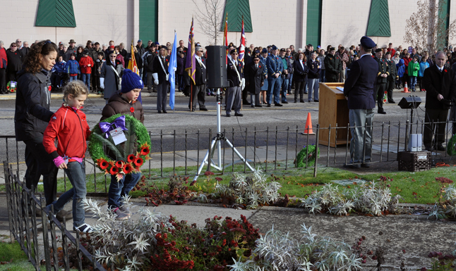 Sarah Newton and her children Nelson and Alexandra laid a wreath on behalf of MLA Norm Macdonald. David F. Rooney photo