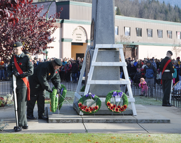 Capt. Miken Rienks, commander of the Rocky Mountain Rangers cadet Corps, lays her wreath at the war memorial. David F. Rooney photo
