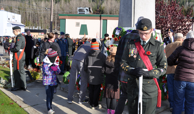 Hundreds of Revelstokians lined up to lay wreaths, crosses and simply poppies at the memorial. David F. Rooney photo
