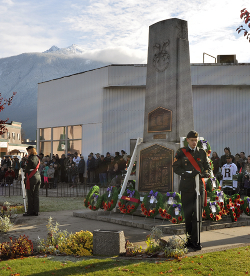 A few minutes later the wreaths have been laid and, as rays of light illuminate the cenotaph, the crowd awaits the finale of the 2013 Remembrance Day ceremony. David F. Rooney photo