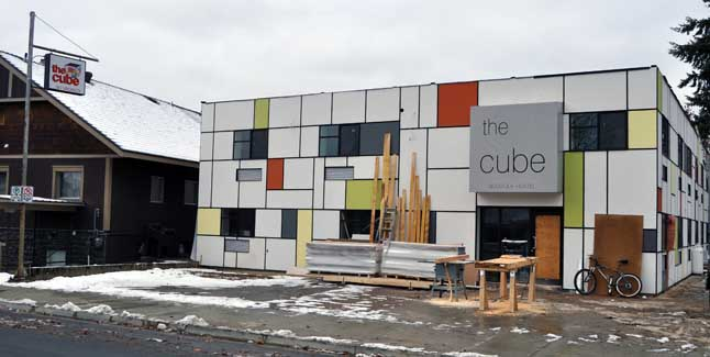 """The Cube, Revelstoke's new """"boutique hostel,"""" has a very distinct look. It's exterior is painted in a Mondrian style. Pieter Cornelis Mondrian (1872 - 1944) was an important Dutch painter whose neoplasticism style was an important contribution to modern painting. This exterior makes The Cube a very distinct building in downtown Revelstoke. David F. Rooney photo"""