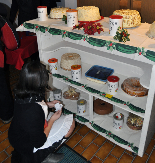 There were also lots of cakes and other delicious desserts that were available by bid. This young lady was eager to put in her bids for the desserts that caught her eye. David F. Rooney photo