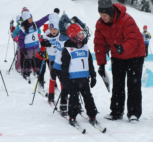 Race official Colleen Wall gives last minute instructions to atom class skiers. Sarah Newton photo