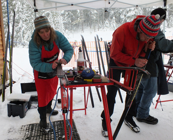 Revelstoke Nordic Waxing Wizard Penny Page Brittin and Head Coach Matt Smider prepare skis for Sunday's race. Waxing conditions were very difficult — new snow at around 0° Celsius made for the worst possible scenario for waxing. Sarah Newton photo