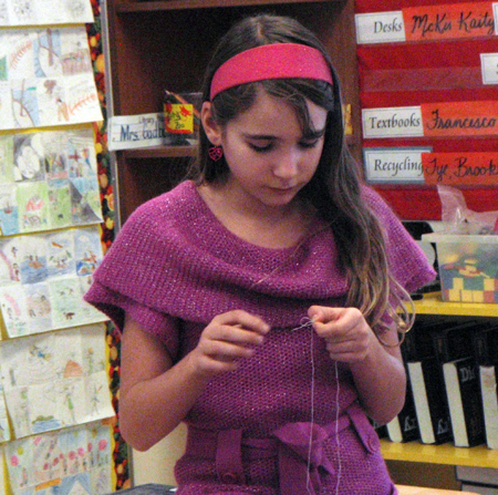 Here Arianna Morone concentrates hard on sewing her mouse. Photo by Alice Dunkerson caption by Amelia Brown AHE Student Reporter-Photographers