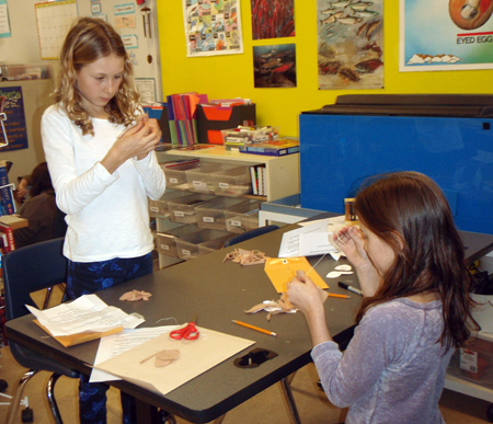 Grade 4/5 students Emily Macleod and Katy Herle work together to have a little fun while making their mice. Photo by Alice Dunkerson caption by Amelia Brown AHE Student Reporter-Photographers