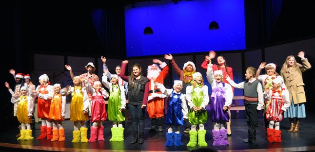 The cast waves at the end of this wonderful Christmas production that is musically lived up by a medley of old-time Christmas favourites by Elvis, Eartha Kit and others as well as singing by Joanne Stacey, Paige Makerawicz, Cecilia Lea (not present at this rehearsal) and Janine Carey Bourque. The 12 elves in this production are Gavin Camara, Sarah Carey, Everet Carter, Madeline Carter, Aza Deschamps, Holly Hamilton, Sophia Laurence, Mercedes Loeppky, Thomas MacDonald, Donald Robichaud, Brooklynn Webber and Cassie Whyte. Everet Carter also plays Kit's Bishop brother, Michael, and Mary Webber plays Kit's and Michael's mom. David F. Rooney photo