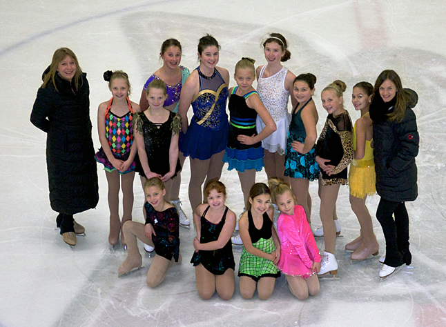 Revelstoke figure skaters brought home some serious bling from the recent Okanagan Interclub Figure Skating Competition. Front left to right: Karlie Beattie, Andie Reynolds, Samantha Veninsky, Lauryn Kline. Back left to right: Coach Adrienne Schurdevin, Makenna Howe, Sophie Dorrius, Megan Cottingham, Jacqueline Cottingham, Alexandra Robertson, Jaimie Reynolds, Cassidy Legebokow, Alexis Larsen, Krystal Kinoshita and Head Coach Nina Greschner. Robert Sims photo