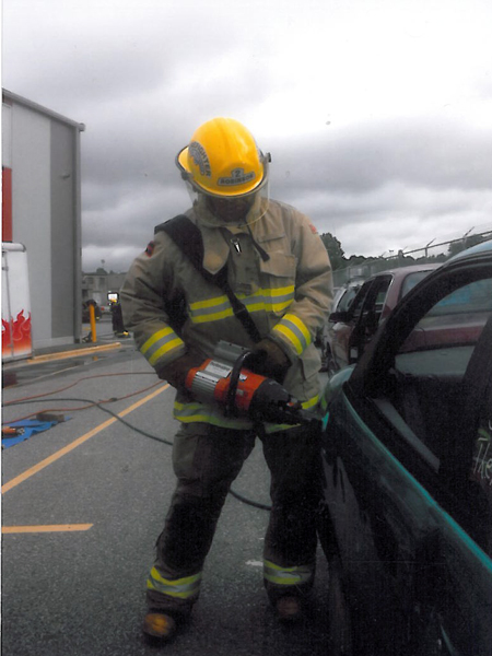 Councillor Phil Welock learns how to crack a car during Fire Ops 101 held at the Vancouver Firefighters Training Centre last autumn. The Fire Ops program is intended to better acquaint city managers, mayors and councillors with firefighting activities. Photo courtesy of Revelstoke Professional Firefighters Local 1746