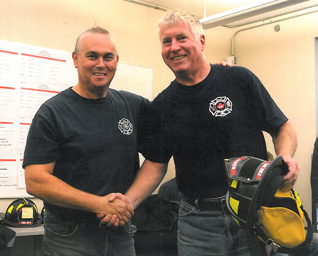 Councillor Welock (right) shakes hands with Jim Blake, one of Revelstoke's professional firefighters, at the end of the program.  Photo courtesy of Revelstoke Professional Firefighters Local 1746