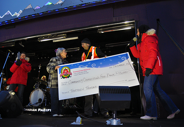 """It takes a very rare and very special occasion for Patti Larson to be struck genuinely speechless. But that's what happened when the CPR's mark Jackson handed here this over-sized cheque for $13,000 — more than four times what the Community Connections Food Bank normally receives. """"I couldn't believe it,"""" she said later. """"I just didn't know what to say."""" After a couple of false starts, though, Patti managed some very profuse than yous. David F. Rooney photo"""