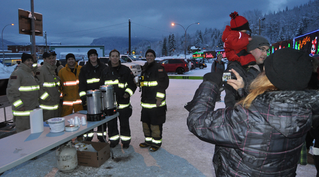 Revelstoke firefighters lineup for a group photo taken by Francine Hoyle. The firefighters serve up hotdogs and hot cocoa and coffee every year. They were sold out pretty quickly. David F. Rooney photo
