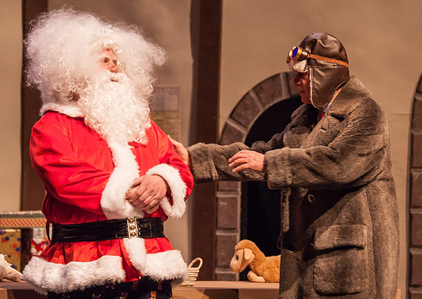 Lou Flapdoodle (played by Denny Kaulback), Dear Santa's slick sleigh salesman (try saying that fast), consoles Santa (played by Bob Loeppky) after a harrowing test drive of Lou's rocket-powered sleigh. Jason Portras photo