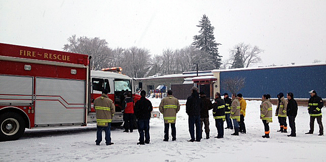 Revelstoke's Highway Rescue Service resumed duty with a leased rescue truck at 4 pm Monday, December 30, 10 days after the original truck was badly damaged on the Trans Canada. Here are members of Revelstoke Fire Rescue getting their first glimpse of the interim truck. Photo courtesy of Revelstoke Fire Rescue