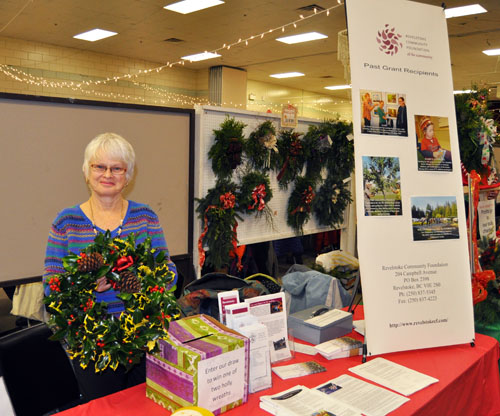 Community Foundation Director Vivian Mitchell displays one of  the gorgeous holly wreathes the Foundation was offering in a draw. Winning that made someone's day! David F. Rooney photo