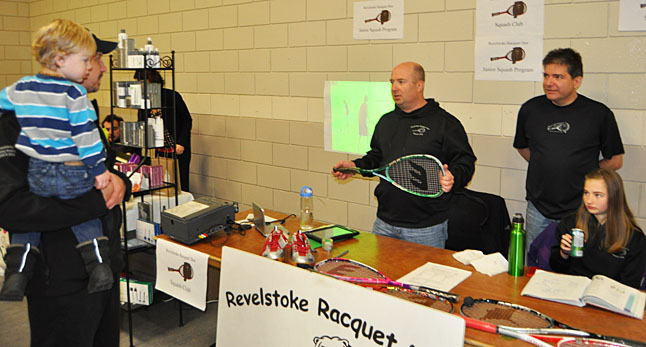 Kevin Dorrius (center right) and Norm Langlois make their pitch to a prospective new member of the Revelstoke Racquet Club. David F. Rooney photo