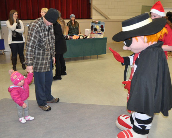 Well, lookee here — the McDonald's Hamburgler makes a small friend at the bazaar. David F. Rooney photo
