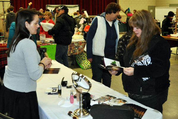 Tamara Scholts talks with a customer at her Younique beauty products table. Her cosmetics are chemical-free. David F. Rooney photo