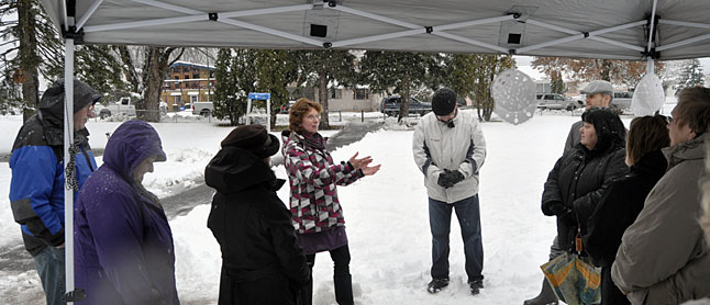 Robyn Abear, acting Hospice Society president, welcomes the men and women who gathered at the park. David F. Rooney photo