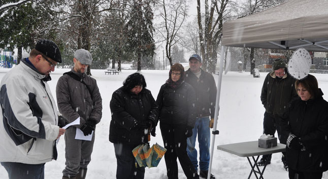 Gary Sulz always has something to say that brings comfort to those who are in mourning. He was followed by Rev. Matt Carter (second from the left) of the Alliance Church who led the assemblage in a touching prayer. David F. Rooney photo