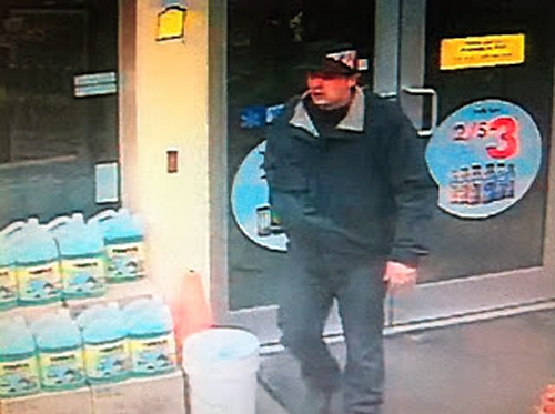 An adult male Caucasian who entered the Shell service station at the junction of Victoria Road and the Trans-Canada on Thursday, December 19, at 11:42 pm threatened violence against the teller if he didn't hand over cash from the til. Surveillance video image courtesy of the Revelstoke RCMP