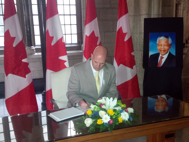 Kootenay Columbia MP David Wilks signs the Book of Condolence created to mark the passing of South African Liberator Nelson Mandela at age 95. Photo courtesy of MP David Wilks